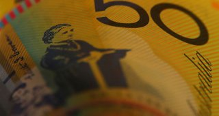 Dollar dips, Aussie gains as traders bet on pandemic recovery