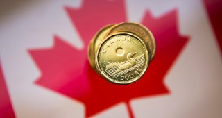 Canadian dollar strengthens along with gains on Wall Street