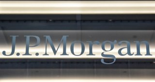 JPMorgan braces for loan losses as trading props up profit