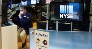 Wall St. ends higher as investors eye stimulus