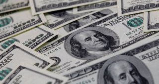 Dollar hits fresh three-year lows against commodity-linked currencies
