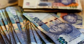 South Africa's rand flat, set for weekly gains on recovery optimism