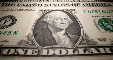 Dollar dips on improved risk appetite, traders eye jobs data