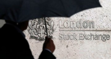 FTSE 100 hits over 1-year high on strong earnings; BoE slows bond-buying