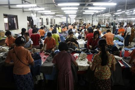 Workers tailor and arrange clothing at a garment factory at Hlaing Tar Yar industry zone in Yangon