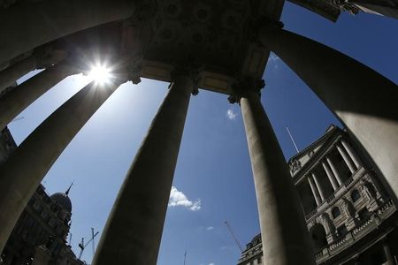 The Bank of England is seen through columns in London