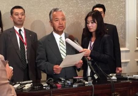 Japanese Economy Minister Akira Amari speaks to media during a break in the Trans-Pacific Partnership talks in Atlanta