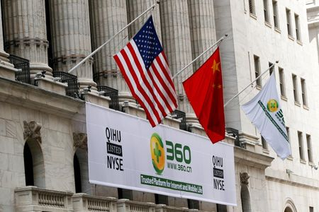 A sign advertising the Qihoo 360 Technology Co Ltd is hung with the U.S. and Chinese flags outside of the New York Stock Exchange