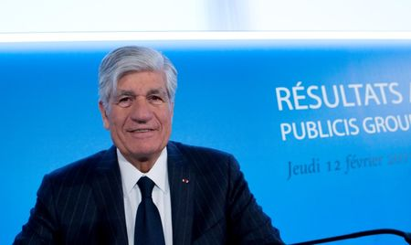 Maurice Levy, French advertising group Publicis Chief executive, poses before the company's 2014 annual results presentation in Paris