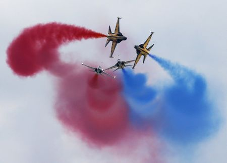 South Korea's Black Eagles aerobatics team perform a maneuver during a preview of the Singapore Airshow at Changi exhibition center in Singapore