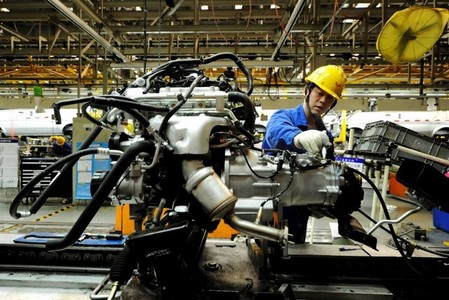 File photo of an employee working on an assembly line producing automobiles at a factory in Qingdao