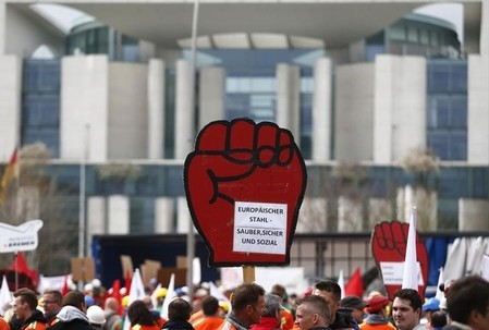 German IG Metall union workers demonstrate in front of the Chancellery in Berlin