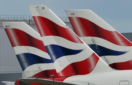 File photo of British Airways logos on tailfins at  Heathrow Airport in London