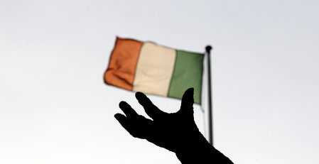 File photo of Ireland's national flag flying above a statue in Dublin