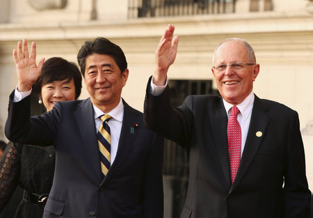 Japanese Prime Minister Shinzo Abe and Peru's President Pedro Pablo Kuczynski wave as they meet at the presidential palace ahead of the 2016 APEC (Asia-Pacific Economic Cooperation) summit in Lima