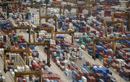 Containers are stacked up at PSA's Tanjong Pagar container terminal in Singapore