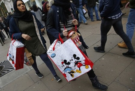 Shoppers carry bags on Oxford Street in London