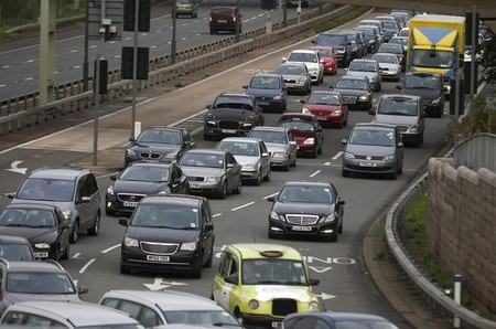 A traffic jam is seen as cars head towards the approach tunnel of Heathrow Airport, west London