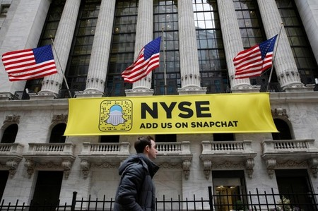 A Snapchat sign hangs on the facade of the NYSE in New York City