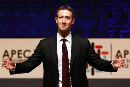 Mark Zuckerberg gestures while addressing the audience during a meeting of the APEC CEO Summit in Lima