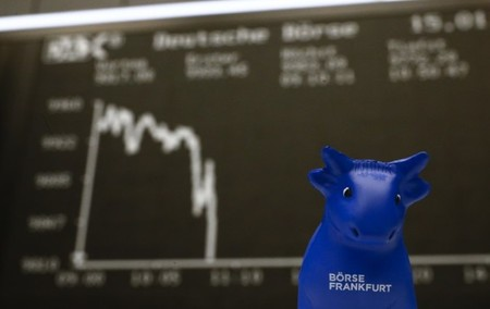 A plastic bull figurine, symbol of the Frankfurt stock exchange is pictured in front of the German share price index DAX board at the Frankfurt stock exchange