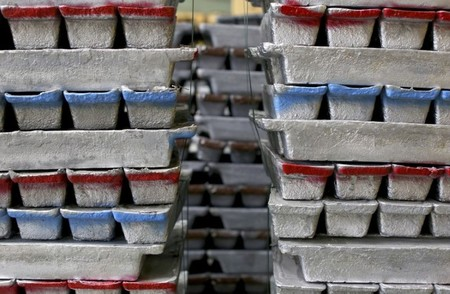 Stacks of leads bars, used for preparing FIAMM batteries, are seen as they are charged in this photo illustration taken at the battery maker's factory in Avezzano, near L'Aquila