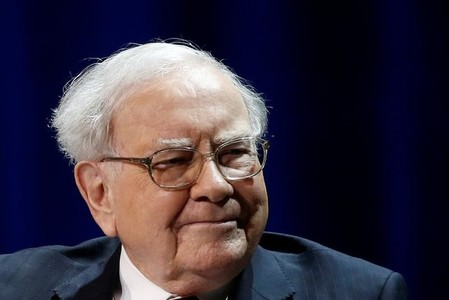 Warren Buffett, chairman and CEO of Berkshire Hathaway, smiles before speaking with Bill Gates (not pictured), at Columbia University in New York