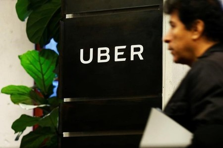 A man exits the Uber offices in Queens, New York