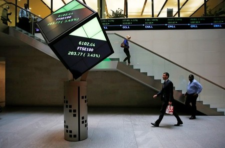 FILE PHOTO -  People walk through the lobby of the London Stock Exchange in London