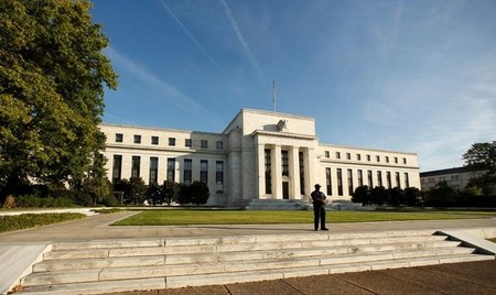FILE PHOTO - A police officer keeps watch in front of the U.S. Federal Reserve in Washington