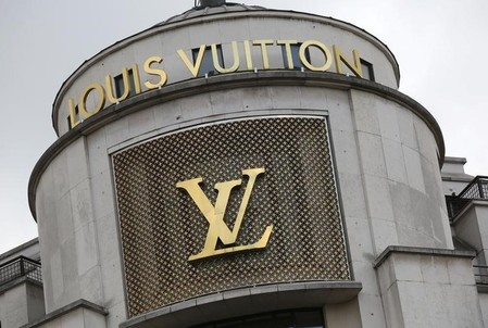 The logo of French luxury group Louis Vuitton is seen at a store in Paris