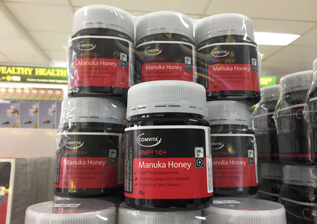 Jars of Comvita brand Manuka honey from New Zealand are photographed on the shelves of a health food store in Sydney