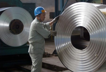FILE PHOTO: Labourer works at cold-rolling mill on outskirts of Wuhan