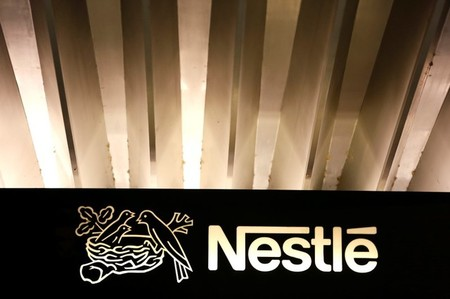 The Nestle logo is pictured on the company headquarters entrance building in Vevey