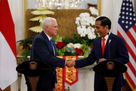 US VP Pence shakes hands with Indonesia's President Widodo at Presidential Palace in Jakarta
