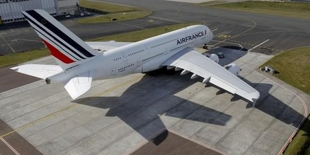 An Air France Airbus A 380 is parked on the tarmac at Charles de Gaulle airport near Paris