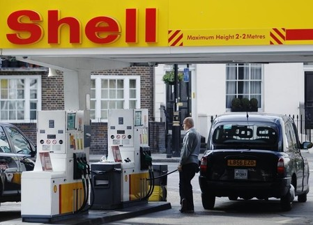 A driver fills up with fuel at a Shell petrol station in London