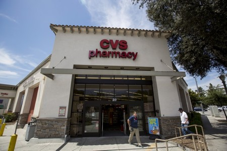 People walk outside a CVS store in Pasadena