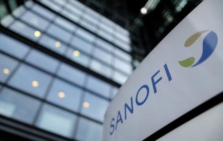 FILE PHOTO - A logo is seen in front of the entrance at the headquarters of French drugmaker Sanofi in Paris