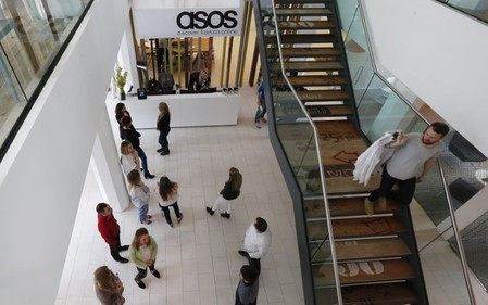 New employees wait in the lobby on their first day of work at the ASOS headquarters in London