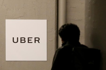 FILE PHOTO -  A man arrives at the Uber offices in Queens, New York