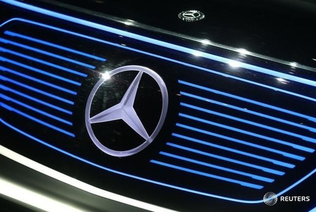A Mercedes sign is seen on the car before the Daimler annual shareholder meeting in Berlin