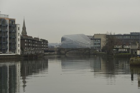 Residential apartments and the Aviva Stadium are reflected in water in the Grand Canal Dock area of Dublin