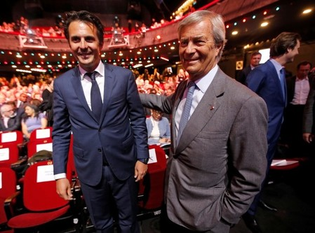 Vincent Bollore, Chairman of media group Vivendi and his son Yannick Bollore, Chairman and CEO of Havas Group, attend the company's shareholders meeting in Paris