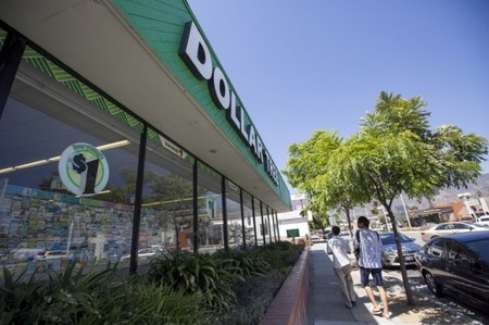 People walk by a Dollar Tree store in Pasadena