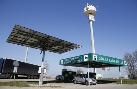 A car is seen parked at a service station for electric cars powered by solar energy in Wolpertshausen