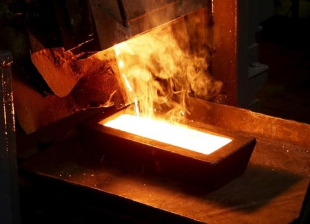 FILE PHOTO: A melter casts an ingot of 92.96 percent pure gold at a procession plant of the Olimpiada gold operation in Krasnoyarsk region