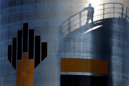 FILE PHOTO: The shadow of worker is seen at a Russian oil field