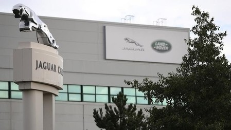 Signs are seen outside the Jaguar Land Rover plant at Halewood in Liverpool, northern England.