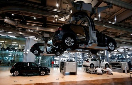 Workers assemble a VW e-Golf electric car in Dresden